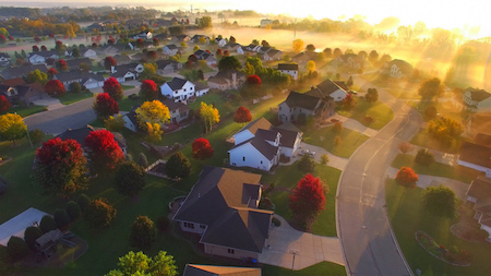 Magical sunrise over sleepy, foggy neighborhood